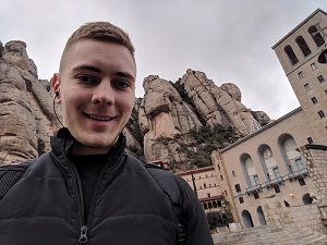 Montserrat, Catalonia, Spain - Selfie with Santa Maria de Montserrat Abbey in the background during my trip to Barcelona