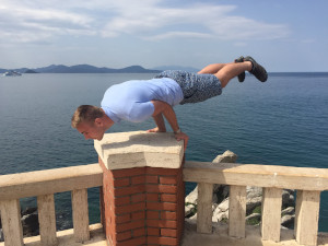 Piombino, Tuscany, Italy - Showing off my elbow lever by the lighthouse before our ferry ride to Elba during my 2018 April tour to Italy.