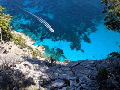 Cala Biriala, Sardinia, Italy - A rowboat from the cliffs above on my hike to Cala Biriala on our trip to Sardinia in 2019