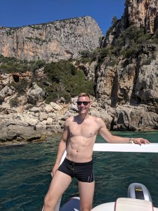 Pedra Longa, Sardinia, Italy - Me, posing with beautiful cliffs in the background while taking a boat ride